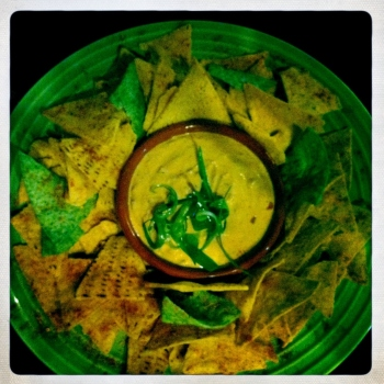 Chilli Con Queso Dip - Warm Mexican cheese dip with herbs and spices served with toasted corn chips (AU$14)