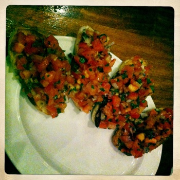 Bruschetta - Toasted Italian bread topped with fresh tomato, basil, red onion, garlic and olive oil (AU$12)