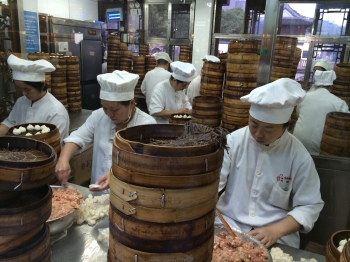 Busy workers inside the Nanxiang Steamed Bun Restaurant