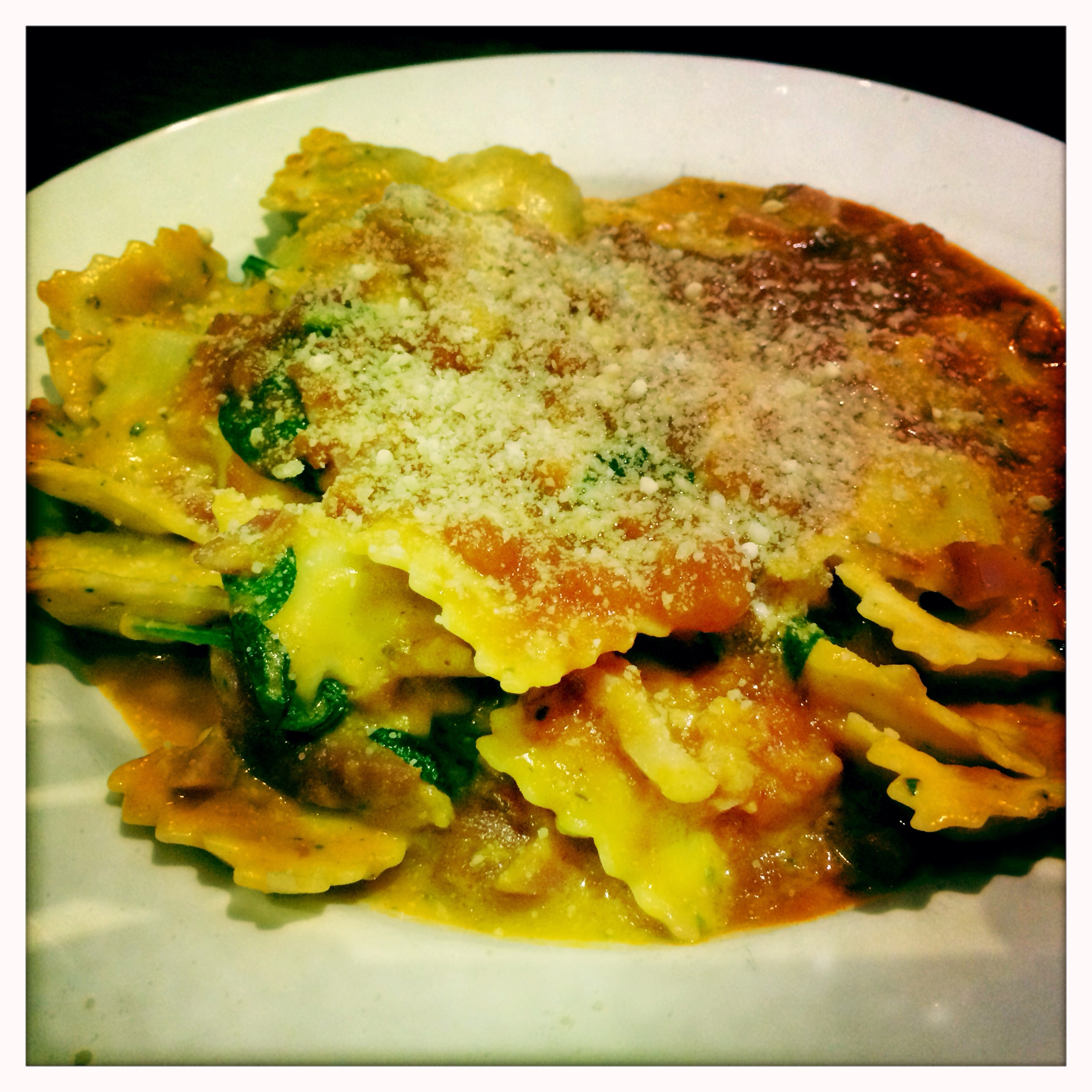 ... bacon, baby spinach and white wine in a Napoli and cream based sauce