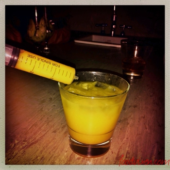 Tequila and Orange Juice with a syringe for good measure