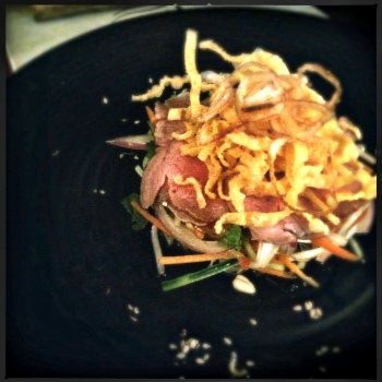 Entrée - Thai Beef Salad with Medium Roasted Veal Back Strap, Cucumber, Fresh Herbs, Nam Jim Dressing, Crispy Shallots and Fried Wonton Skins